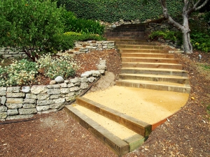 After: The new walkway from our home to the garden is composed of six-foot wide curving steps and level landings. It's astounding how much more of a pleasure it is to walk on a well-designed and built set of steps.