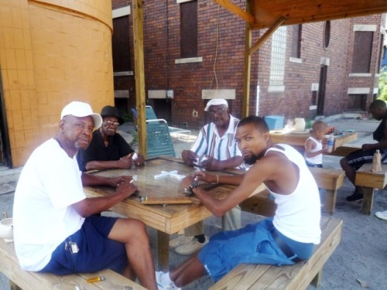Central Detroit residents have transformed an abandoned gas station into a gathering place at Peaches & Greens, complete with new furniture and a pavilion structure to protect domino players from the elements. / Photo: Steve Davies / Peaches & Greens